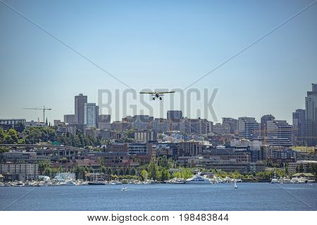 Float Plane Taking Off In Seattle On T He Bay