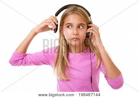 Lovely teenage girl removing her headphones for noise or loud music over white background