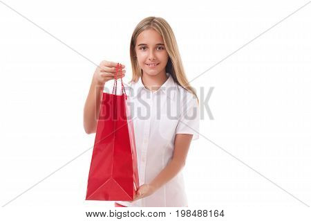 shopping sale christmas and holiday-lovely young girl giving red shopping bag isolated over white background shopping sale christmas and holiday concept - smiling elegant woman in red dress with shopping bags