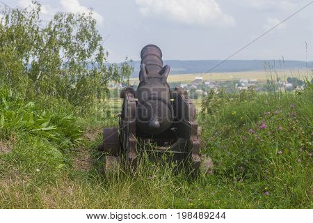 Old Cannon Gun on Green Hills backview