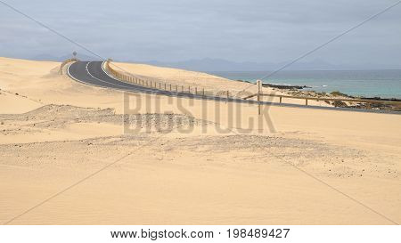 Curved road in the Corralejo Dunes - the Natural Reserve on the Canary Island Fuerteventura Spain.