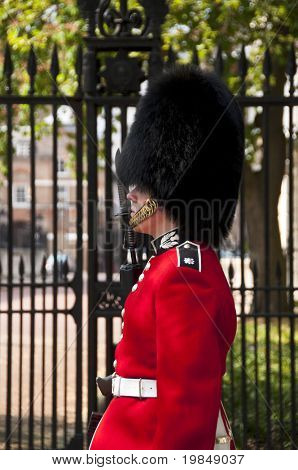 LONDON, UK - APRIL 20: A royal guard outside Clarence House where Prince William will spend the night before the royal wedding to be held on Friday 29th April, April 20, 2011 in London, United Kingdom