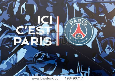 Paris, France - March 28 2016: PSG logo and slogan on the wall of Parc des Princes. Paris Saint-Germain Football club is a French professional association football club based in Paris, France