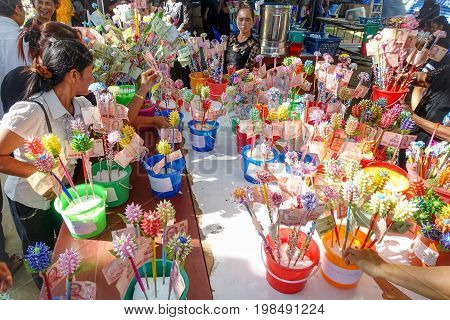 BANGSAPHAN THAILAND - DECEMBER 18 : Unidentified Buddhists are making religious ceremony in money to the priests at the end of Buddhist Lent on December 18 2016 at Bangsaphan District Thailand.