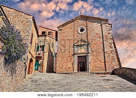 Castiglione d'Orcia, Siena, Tuscany, Italy: renaissance church of the Saints Stefano e Degna in the old Tuscan village poster