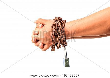 Man's hands tied with chains isolated over white background
