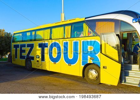 Sharm El Sheikh, Egypt - April 07, 2017: The tour bus by TEZ Tour waiting for tourists at airport of Sharm El Sheikh, Egypt.