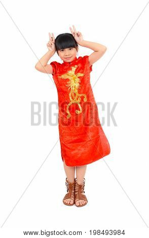 Full length portrait of happy Asian girl in chinese dress (9 years) on white background