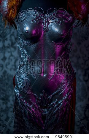 Metallic Fantasy, woman armor. Strong handmade metal breastplate in silver with gothic shapes and fine steel strands