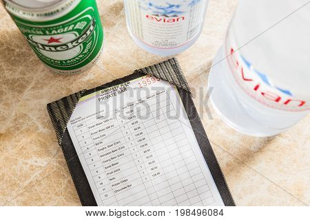 Phuket Thailand - 8 July 2017 - in-room hotel shack and drink price list lays on a marble table showing various snacks and beverages pricing in Thai Baht in Phuket Thailand on July 8 2017.