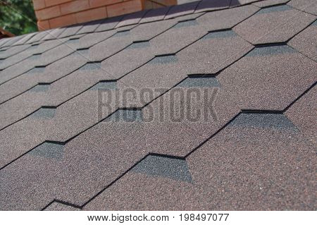 Soft tile roofing material on the living house.