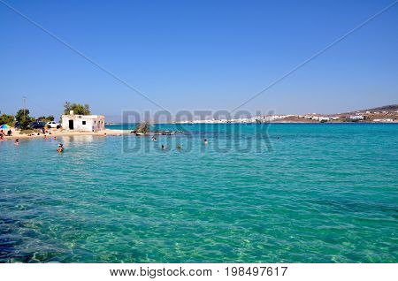 View from kolimbithres beach to Naoussa town on Paros island in Greece