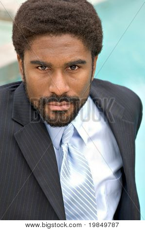Handsome African-American businessman by the side of a pool