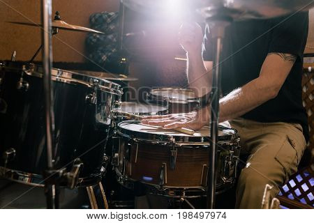 Musician with drums. Professional drum set closeup. Drummer playing music on live concert