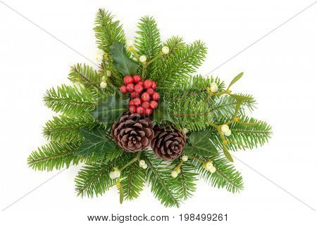 Winter holly, fir, ivy, mistletoe and pine cones on white background.