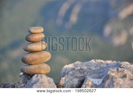 Balanced stone pyramid on mountain. Zen rock, concept of balance and harmony