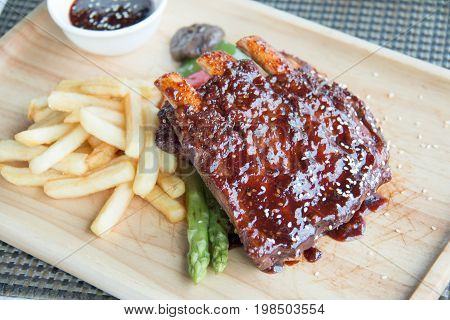 A pork bbq ribs meaty ribs smothered with bbq sauce