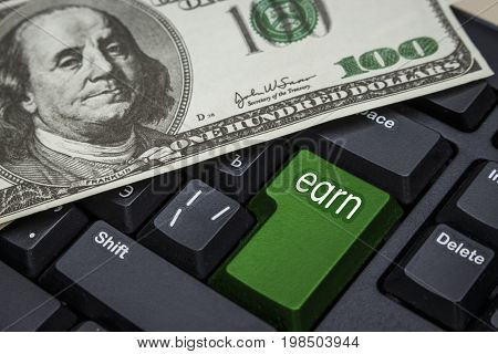 One hundred dollars on a computer keyboard with the