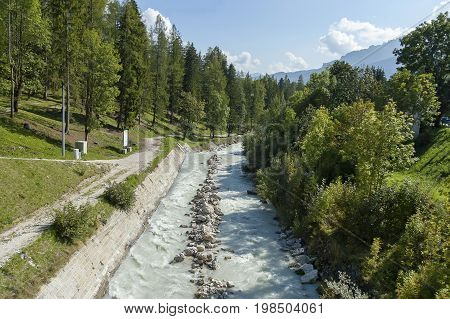 Beautiful view of the Boite river with open sediment from rosk  and mountain in Cortina d'Ampezzo, Dolomite mountains,  Alps, Veneto, Italy, Europe