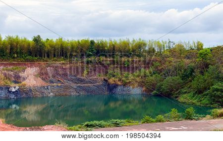 The Old Mine Full With Green Jade Color Water In Mountain Region In Thailand