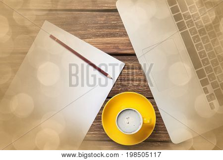 Cup Of Coffee And Paper With Laptop Computer