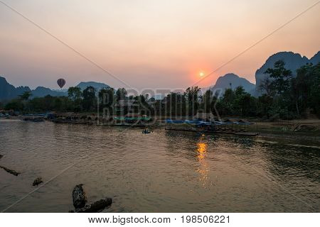 The beautiful sunset over Nam Song River with hot air ballon in Vang Vieng Laos.