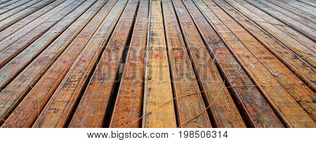 Perspective of old brown wooden plank background at the beach