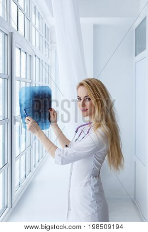 Young Beautiful Woman Doctor With Stethoscope And X-ray