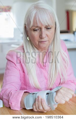 Mature Woman Suffering From Wrist Injury At Home