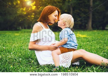 Loving Mother And Her Son On Nature