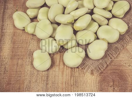 Green Fresh Broad Beans On Old Wooden Table.
