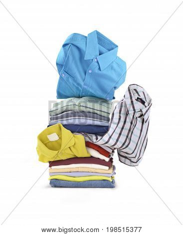 A stack of shirts.On a white background a stack of folded bright shirts.