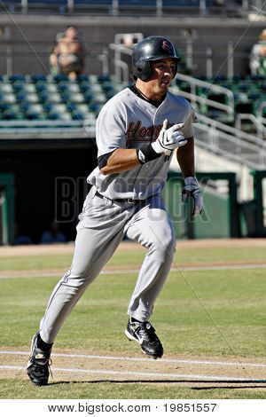 MESA, AZ - NOV 20: Brian Bogusevic of the Scottsdale Scorpions runs to first base in the Arizona Fall League game with the Mesa Solar Sox  on November 20, 2008 in Mesa, Arizona.