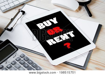 Text message Buy or rent on Tablet screen with office table. Business concept