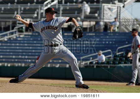 MESA, AZ - NOV 20: Kevin Pucetas of the Scottsdale Scorpions pitches in the Arizona Fall League baseball game with the Mesa Solar Sox on November 20, 2008 in Mesa, Arizona.