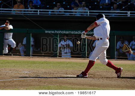 MESA, AZ - NOV 20: Jeremy Slayden of the Mesa Solar Sox hits in an Arizona Fall League baseball game between with the Scottsdale Scorpions on November 20, 2008 in Mesa, Arizona.