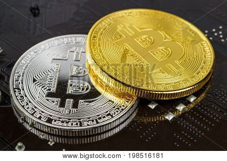 Silver And Golden Bitcoins On The Black Background Closeup. Cryptocurrency Virtual Money