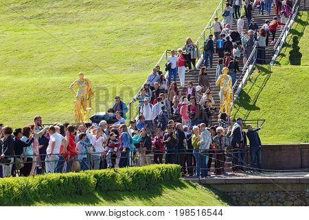 PETERHOF/ RUSSIA - JULY 2, 2017. Crowd of tourists at the waterfall stairs of the Grand Cascade in the park of Peterhof. Saint Petersburg, Russia.