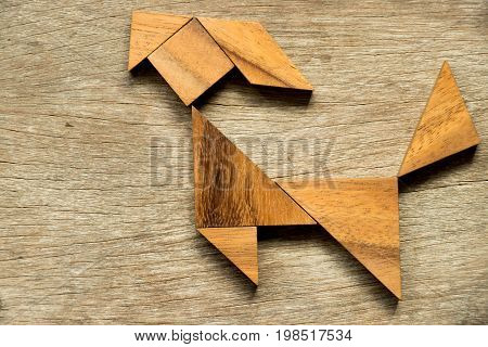Wood tangram puzzle in goat shape background