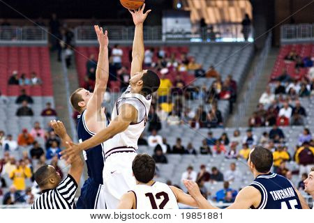 GLENDALE, AZ - DECEMBER 20: ASU forward Jeff Pendergraph #4 faces BYU center Chris Miles #54 in the opening tip-off of the basketball game on December 20, 2008 in Glendale, Arizona
