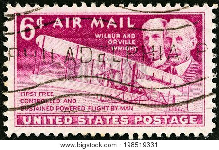 USA - CIRCA 1949: A stamp printed in USA issued for the 46th anniversary of Wright Brothers' First Flight shows Wright brothers and Wright Flyer I plane, circa 1949.