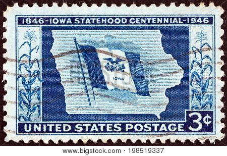 USA - CIRCA 1946: A stamp printed in USA issued for the Centenary of Iowa Statehood shows Iowa State Flag and Map, circa 1946.