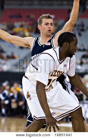 GLENDALE, AZ - DECEMBER 20: James Harden #13 of Arizona State is guarded by Emery Jackson #3 of Brigham Young University during the basketball game on December 20, 2008 in Glendale, Arizona.