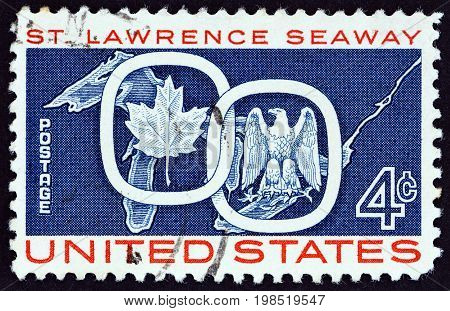 USA - CIRCA 1959: A stamp printed in USA from the issued for the opening of St. Lawrence Seaway shows Maple Leaf linked with American Eagle, circa 1959.