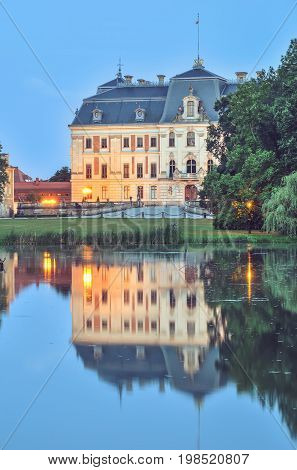 Castle in Pszczyna town in Poland. Beautiful antique neo baroque castle by evening.