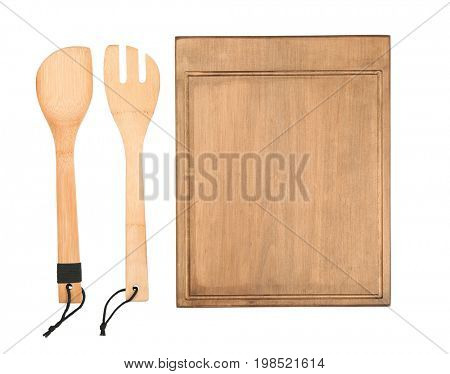 Wooden board and utensils on white background