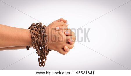 Man's hands tied with chains isolated on white background