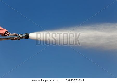 Spray water on truck during fire training in the industry