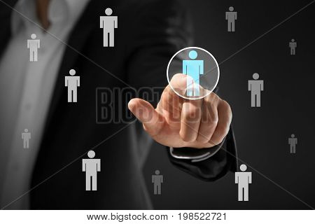 Man working with virtual screen, closeup. Concept of human resources management