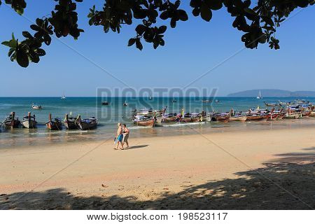AO NANG THAILAND FEBRUARY 14 2017 : Longtail boats for tourists at Ao Nang the famous beach in Krabi province Thailand